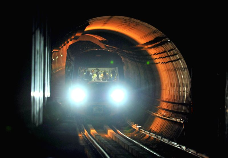 A Metro train enters the underground tunnel for the first time at Cubbon Park Metro Station under the Minsk Square in Bengaluru, on March 12, 2015.