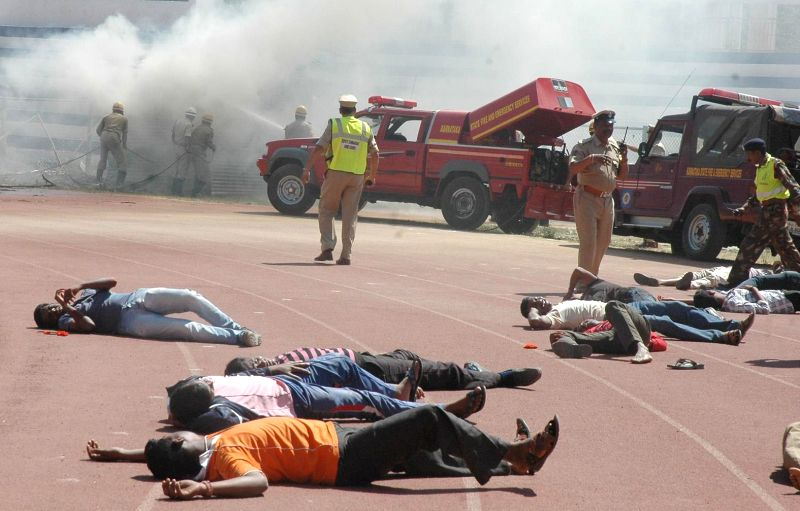 A mock drill underway during the National Disaster Reduction Day and Rally at Kanteerva Stadium in Bengaluru, on Feb 6, 2015.