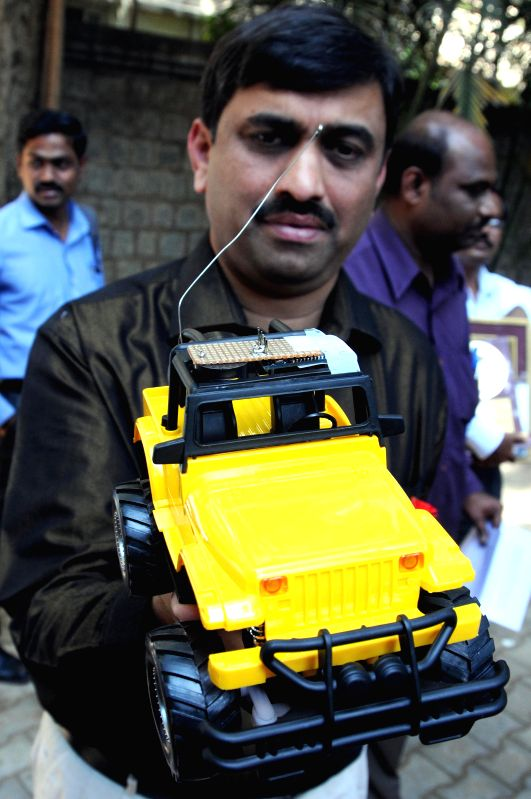 A model of `Samvid`- a technology developed by Sahaj Software solutions that claims to help out the visually challenged people in commuting, being displayed in Bangalore on Dec 3, 2014.