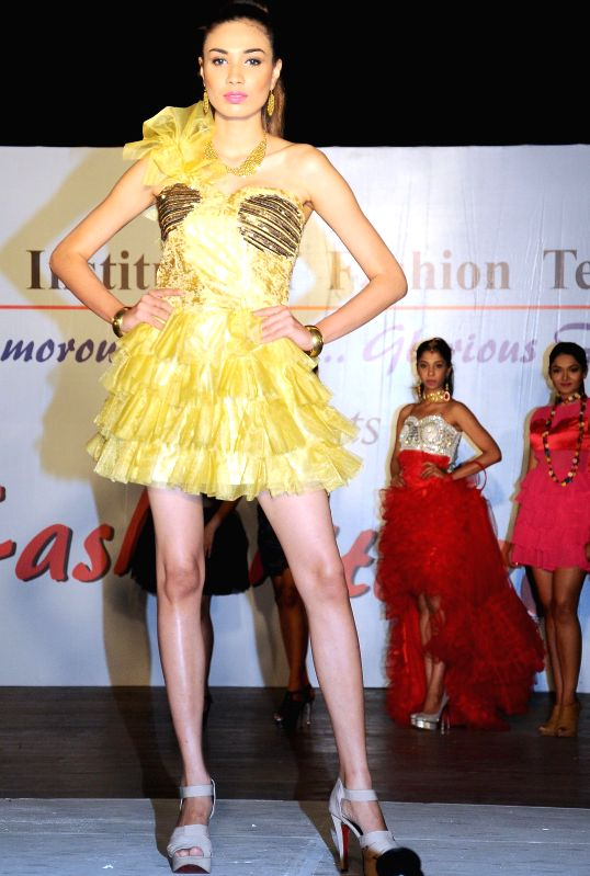 A model walks the ramp during Fashionite - 2015 in Bengaluru, on March 31, 2015.