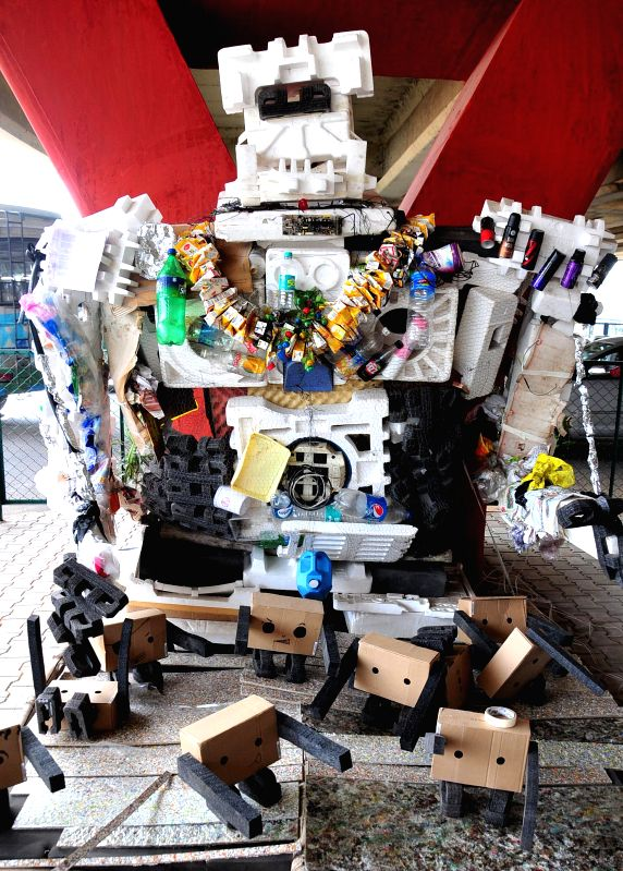 A replica of robot made from Garbage (used bottle, thermocal, juice packet etc.) during `Kasa Market` (best price and better place for garbage) exhibition cum sale at Below Silk Board ...