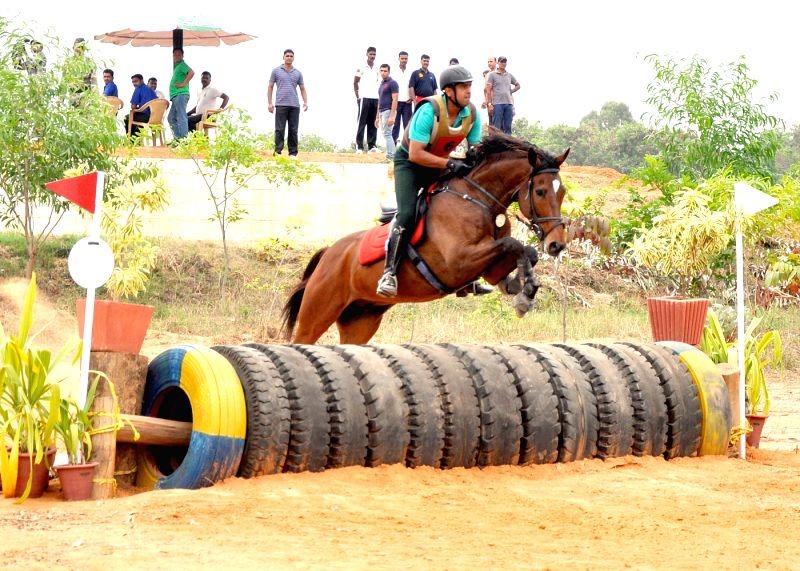 A rider participate​s​ ​in the​ Cross Country Competition of National Equestrian Championship and Bangalore Horse Show, in Bengaluru on April 23, 2015.