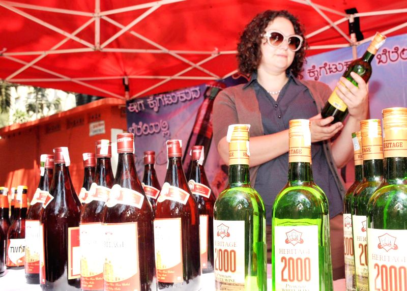 A visitor at the inauguration of wine festival at Press Club, in Bengaluru on Feb 21, 2015.