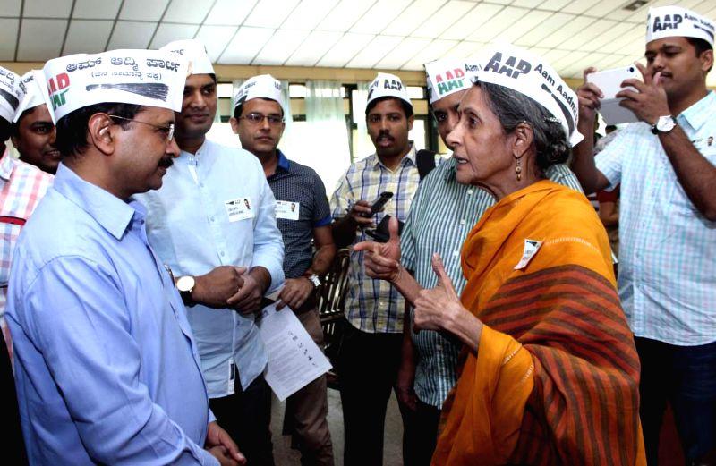 Aam Aadmi Party (AAP) leader Arvind Kejriwal interacts with party leaders during a programme in Bengaluru, on Jan 11, 2015. - Arvind Kejriwal