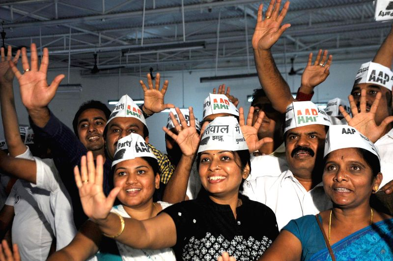 Aam Aadmi Party (AAP) supporters celebrate party's performance in the recently concluded Delhi Assembly Polls in Bengaluru, on Feb 10, 2015.