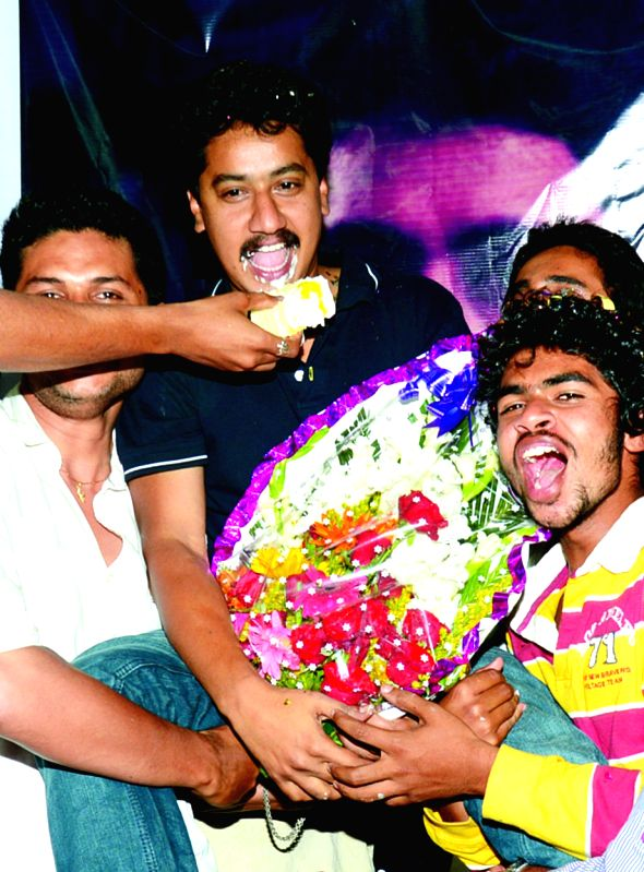 Actor Sanchari Vijay celebrates with friends after winning the best actor award for `Nanu Avanalla Avalu` at the 62nd National Film Awards, in Bengaluru on March 25, 2015.