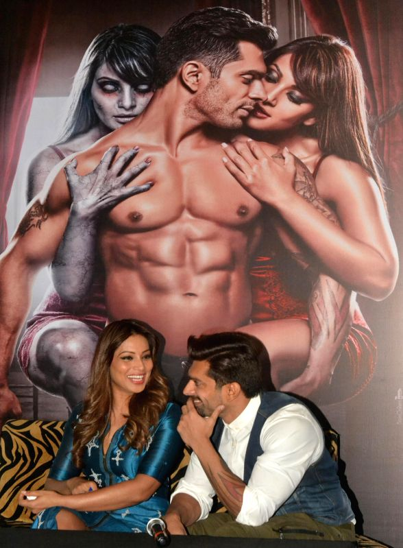 Actors ​​Bipasha Basu and Karan Singh Grover during the promotion of their upcoming film `Alone` in Bengaluru on Dec 20, 2014.