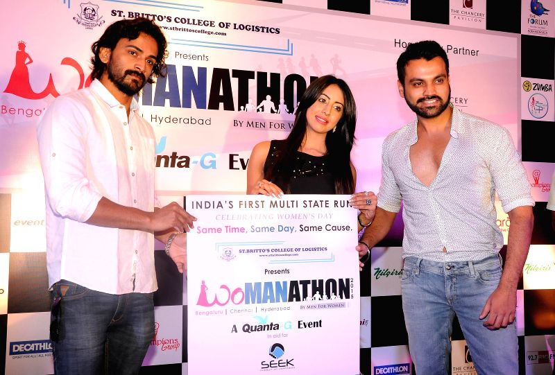 Actors Dhananjay, Sanjana and Tilak during a press conference organised to announce `Womanathon 2015` in Bengaluru, on March 1, 2015. - Dhananjay, Sanjana and Tilak