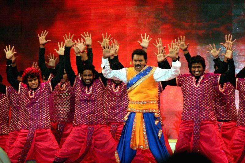 Actors perform during `Amara Jeevige Namana`- a tribute to Dr.Rajkumar  at Palace Grounds in Bengaluru on Nov 30, 2014.