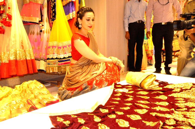 Actress Karisma Kapoor launch a flagship store of a leading treasure house of Fashion in Bengaluru on Nov. 29, 2014.