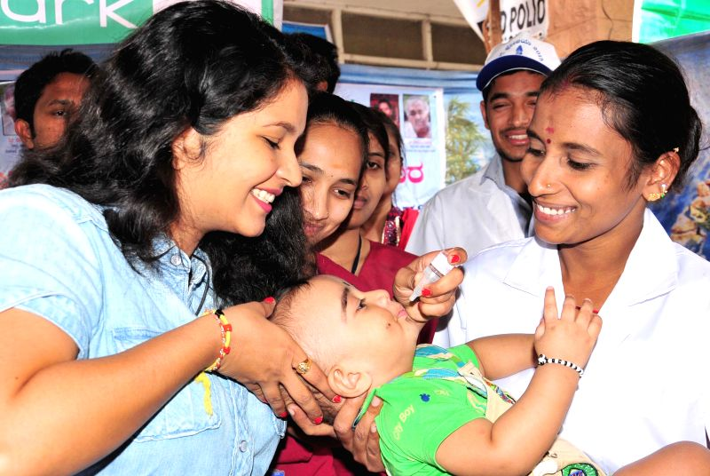 Actress Shubha Poonja administers Polio Drops to a child in Bengaluru, on Jan 18, 2015.
