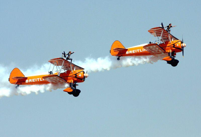 Aeroplanes perform aerobatics at the Aero India Show 2015, at Yelahanka Air-force Station, in Bengaluru on Feb 22, 2015.