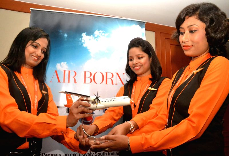 Air hostesses of Air Pegasus at the launch of the airline in Bengaluru on April 1, 2015.