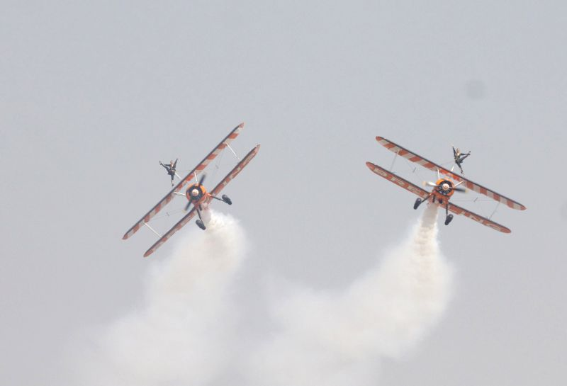 Aircrafts perform aerobatics during the Aero India-2015 Air Show, at Yelahanka Air-force Station, in Bengaluru on Feb 19, 2015.
