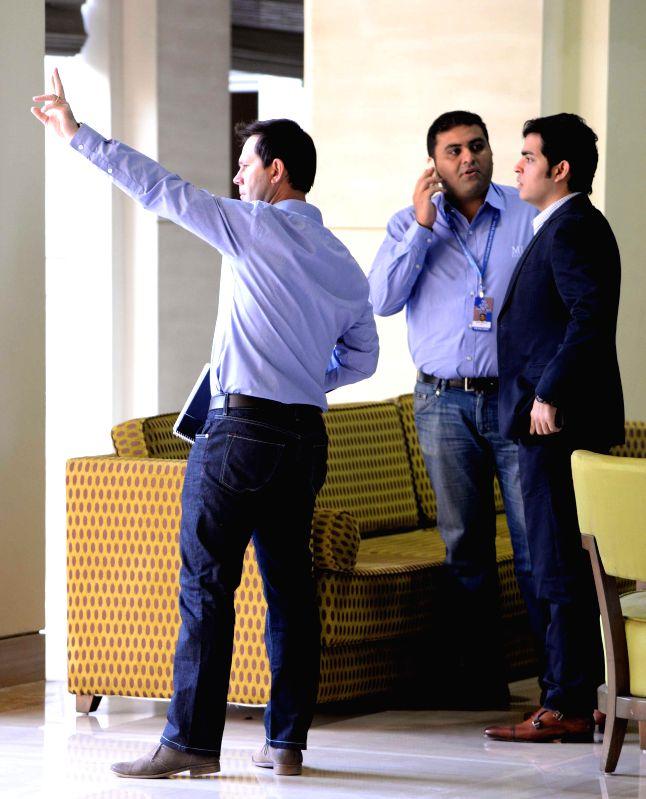 Akash Ambani son of Reliance Industries Limited (RIL) chairman Mukesh Ambani with former Australian cricketer Ricky Ponting at the player auctions of the IPL 2015 edition in Bengaluru, on . - Akash Ambani and Mukesh Ambani