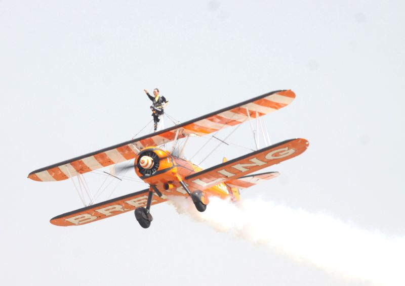 An aircraft performs aerobatics during the Aero India-2015 Air Show, at Yelahanka Air-force Station, in Bengaluru on Feb 19, 2015.