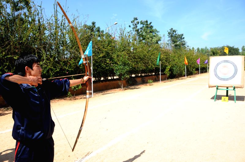 An archer during inauguration of the 17th National Varanasi Archery Competition organised by Akhil Bharatiya Varanasi Kalyan Ashram at Vagedvi Schoo, in Bengaluru on Dec 26, 2014.