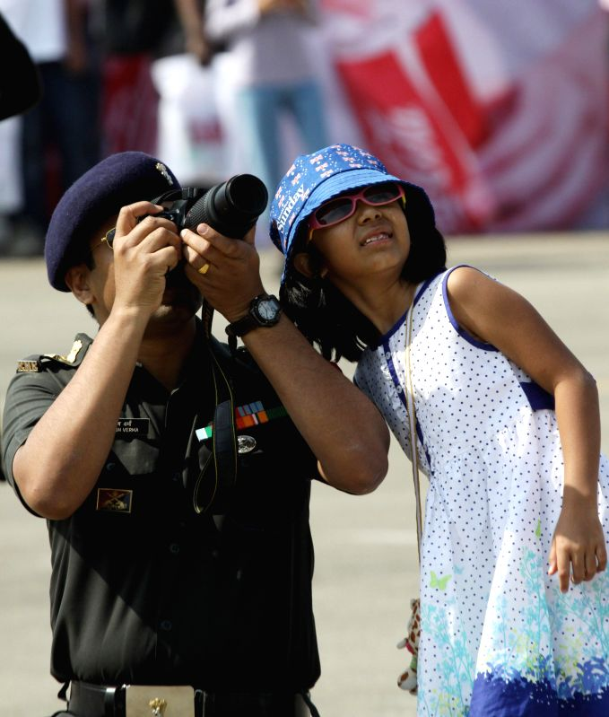 An army-man with a child at the Aero India-2015 Air Show, at Yelahanka Air-force Station, in Bengaluru on Feb 19, 2015.