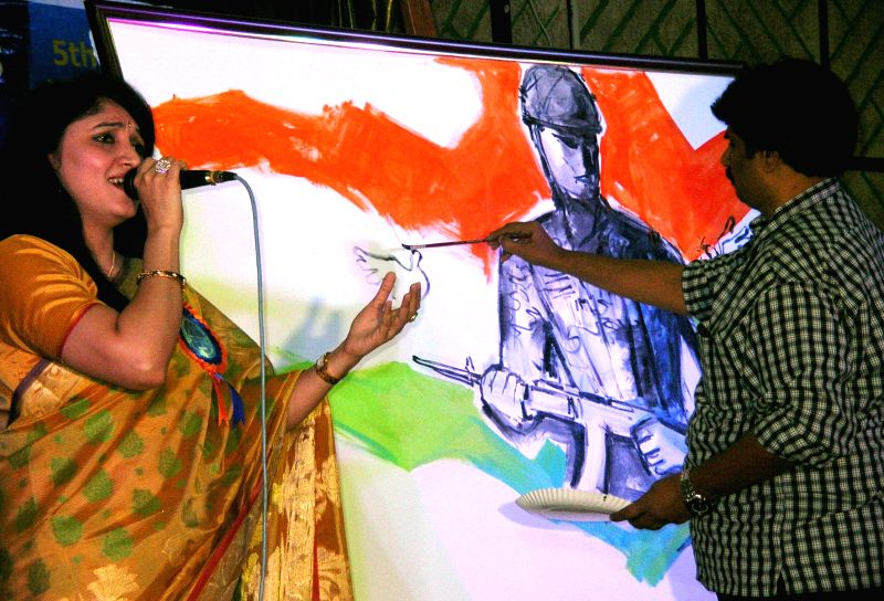 ​An artist paints a picture during `Trigger Youngsters Liberty Forum 2015` organised by​ the​ Karnataka Civil Defence Corps in Bengaluru, on Jan 14, 2015.