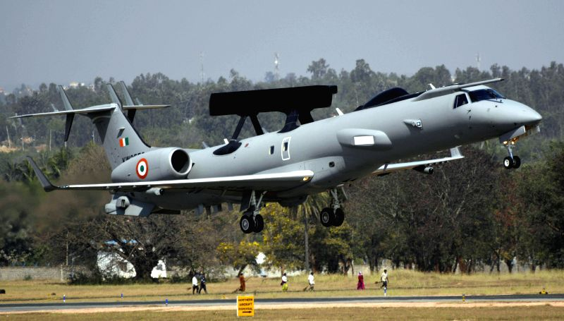 An IAF aircraft performs aerobatics during the Aero India-2015 Air Show, at Yelahanka Air-force Station, in Bengaluru on Feb 19, 2015.
