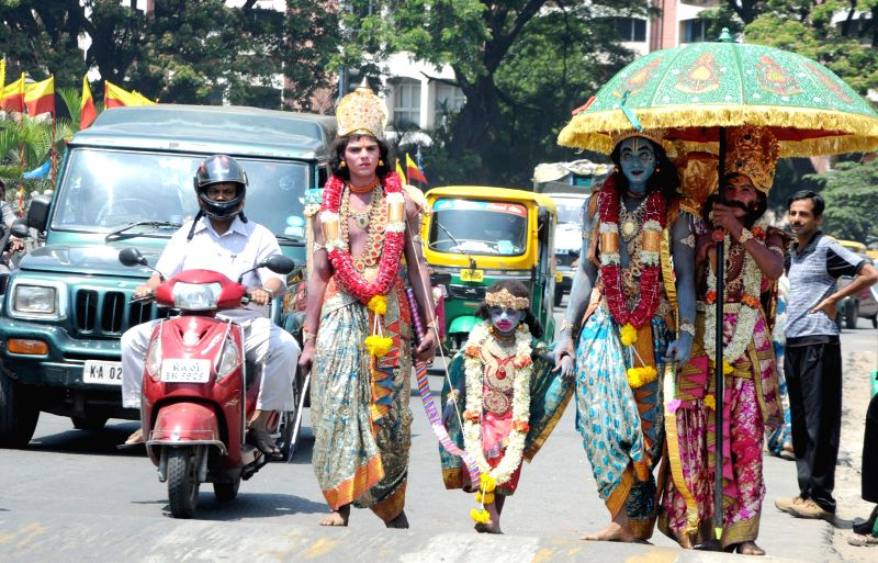 Artists dressed like Ram and Lakshman on the occasion of Ram Navmi in Bengaluru, on March 28, 2015.