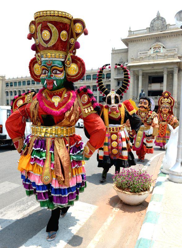 Artists perform during `Sri Devar Dasimayya Jayanti Utsav` outside the Vidhana Soudha, in Bengaluru on March 25, 2015.
