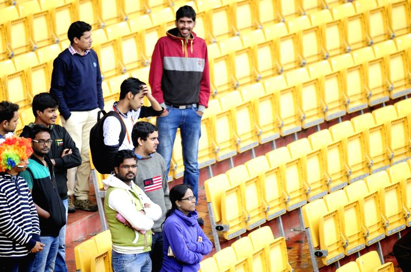 : Bengaluru: Audience wait at the stand as rain delay the start of the 2nd day of the second test match between India and South Africa at M Chinnaswamy Stadium in Bengaluru, on Nov 16, 2015. (Photo: ...