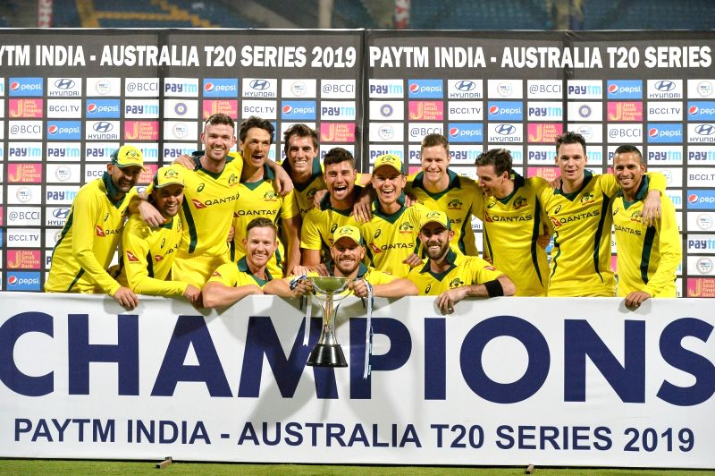 Bengaluru: Australian cricketers celebrate with the trophy after winning the second T20I match against India at M Chinnaswamy Stadium in Bengaluru on Feb 27, 2019. Australia won the T20 series 2-0. (Photo: IANS)