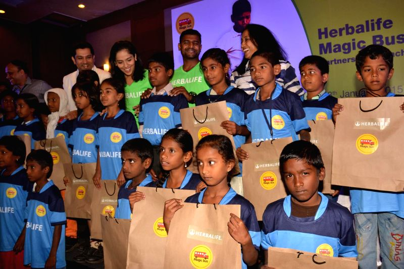 Badminton player Saina Nehwal with Paralympics Silver Medalist HN Girish, former athlete Ashwini Nachappa and others during a press conference in Bengaluru on Jan 8, 2015.
