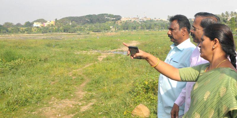 Bangalore Mayor Shanta Kumari inspects the Kempambudi Lake in Bengaluru, on Dec 2, 2014.