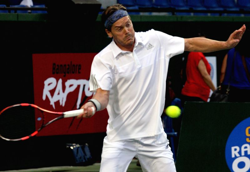 Bangalore Raptors` Thomas Enqvist in action during a Champions Tennis League match against Pune Marathas` Pat Cash at KSLTA, in Bengaluru on Nov. 20, 2014.