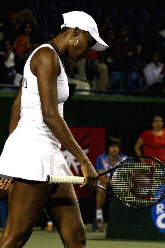 Bangalore Raptors` Venus Williams in action during their women`s singles match of Champions Tennis League against Pune Marathas` Agnieszka Radwanska at KSLTA, in Bengaluru on Nov. 20, ...