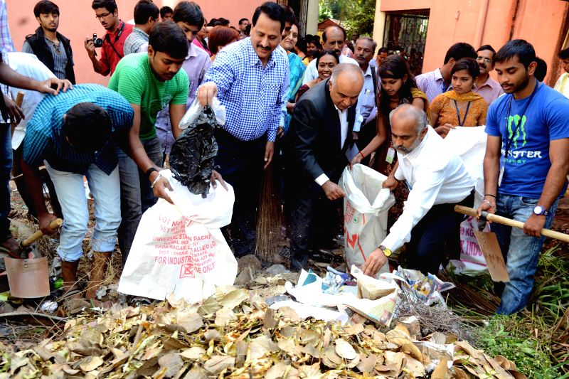 Bangalore University Vice Chancellor, B Thimme Gowda participates in Clean India Campaign at Home Science College, in Bengaluru on Jan 13, 2015.
