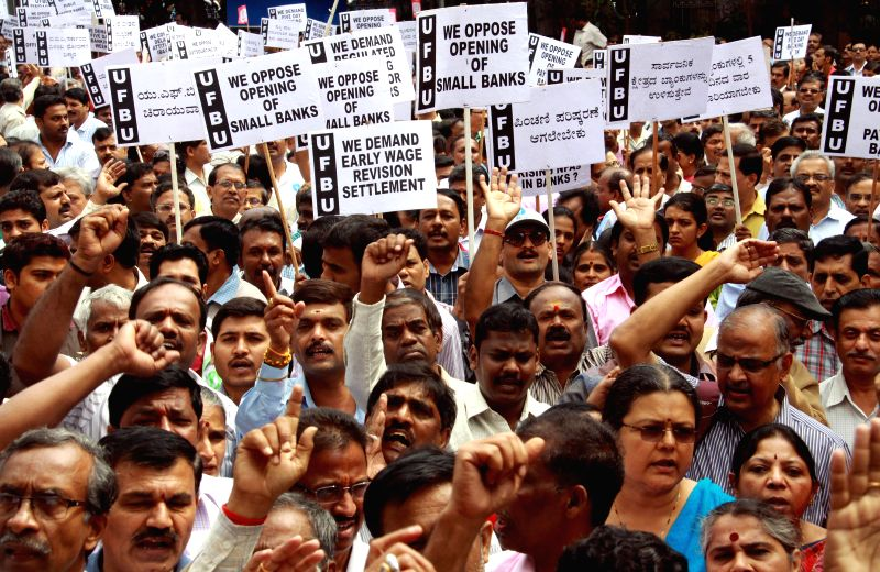 Bank employees stage a demonstration to press for wage revision in Bengaluru, on Dec 2, 2014.