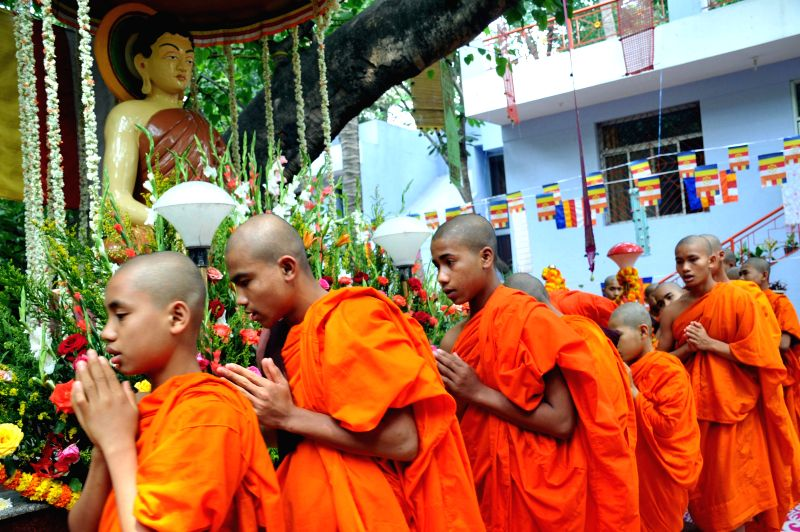 Bengaluru: Buddhist monks offer prayers at a temple on Buddha Purnima, in Bengaluru, on May 4, 2015.