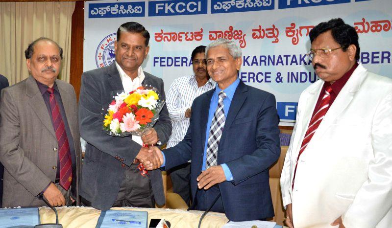 Bengaluru : Bengaluru Police Commissioner M N Reddi and the FKCCI  chief S Sampathraman during an interactive meeting organised by FKCCI, in Bengaluru on Dec 17, 2014.