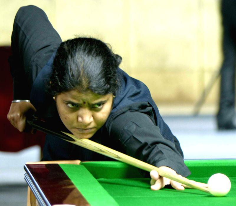 Billiards player Chitra Magimairajan during a game of IBSF World Snooker Championship against Floriza Andal at Kanteerava Stadium , in Bengaluru on Nov 19, 2014.