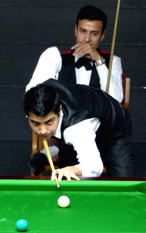 Billiards player Kamal Chawla during a game of IBSF World Snooker Championship against Shahbaazz Adil Khan at Kanteerava Stadium , in Bengaluru on Nov 19, 2014. - Shahbaazz Adil Khan