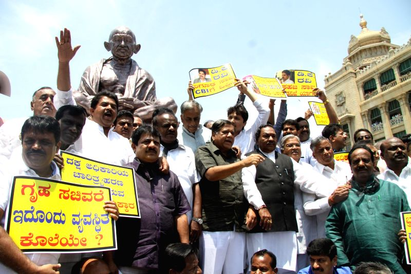 BJP and JDS legislators stage a demonstration to press for CBI probe in the mysterious death case of Karnataka IAS officer in Bengaluru, on March 19, 2015.