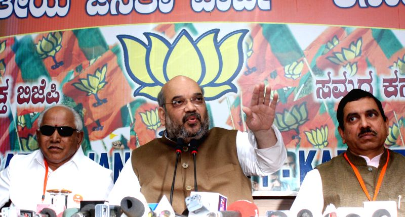 BJP chief Amit Shah addresses a press conference at BJP office in Bengaluru on Jan 3, 2015.