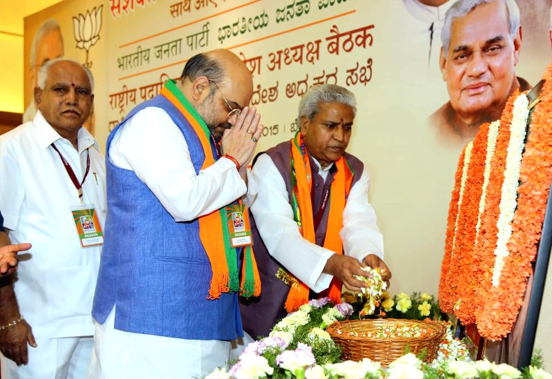 BJP chief Amit Shah at the inauguration of National Executive Committee meeting of the party in Bengaluru, on April 2, 2015. Also seen party leader B S Yeddyurappa. - Amit Shah