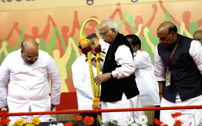 BJP chief Amit Shah, BJP veteran L K Advani and Union Home Minister Rajnath Singh during a public meeting in Bengaluru, on April 3, 2015. - Rajnath Singh, Amit Shah and L K Advani