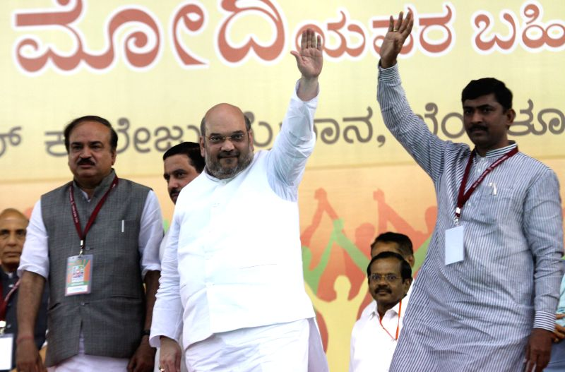 BJP chief Amit Shah during a public meeting in Bengaluru, on April 3, 2015. Also seen Union Chemicals and Fertilizers Minister Ananth Kumar, Karnataka BJP chief Prahalad Joshi and BJP ... - Ananth Kumar, Amit Shah, Prahalad Joshi and Muralidhar Rao
