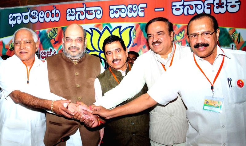 BJP chief Amit Shah with Union Chemicals and Fertilizers Ananth Kumar, Union Railways Minister D.V. Sadananda Gowda and BJP leaders Prahalad Joshi, BS Yeddiyurappa during a press ... - D., Ananth Kumar and Prahalad Joshi