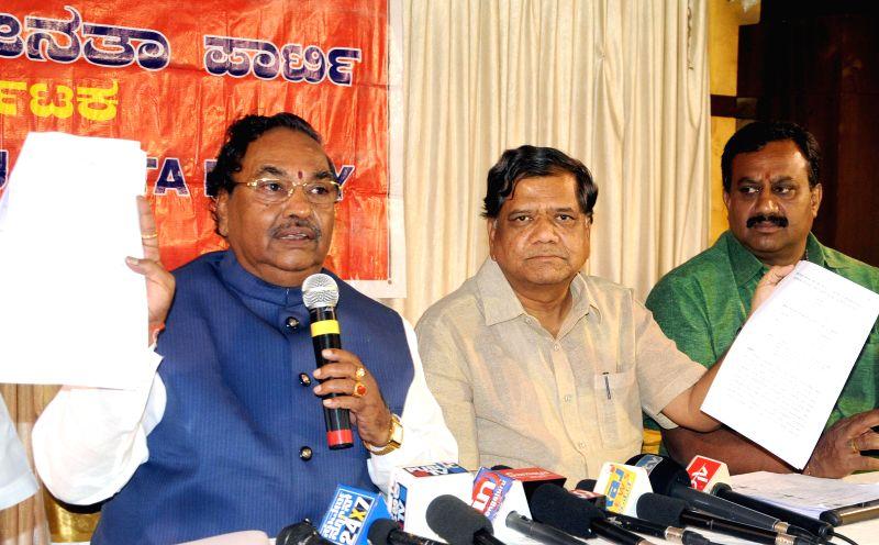 BJP leaders K. S. Eshwarappa, Jagadish Shettar and Ashwath Narayan during a press conference in Bengaluru, on Nov 12, 2014.