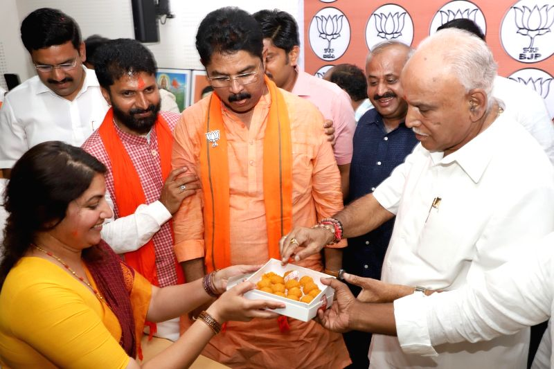 Bengaluru: BJP leaders R. Asoka and B. S. Yeddyurappa celebrate at the Karnataka party headquarters as the BJP led by Prime Minister Narendra Modi is set to retain power for another five years after making a sweep of the Lok Sabha battle and mauling