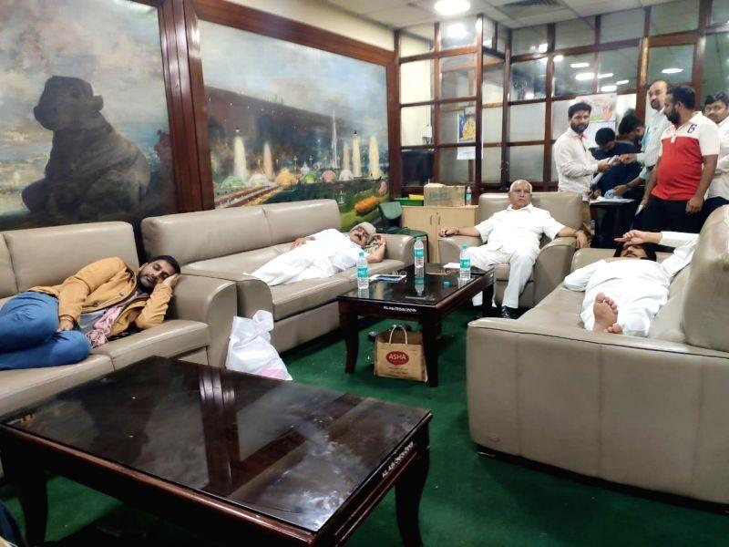 Bengaluru: BJP MLAs sleep at Vidhana Soudha lounge in Bengaluru on July 18, 2019. (Photo: IANS)