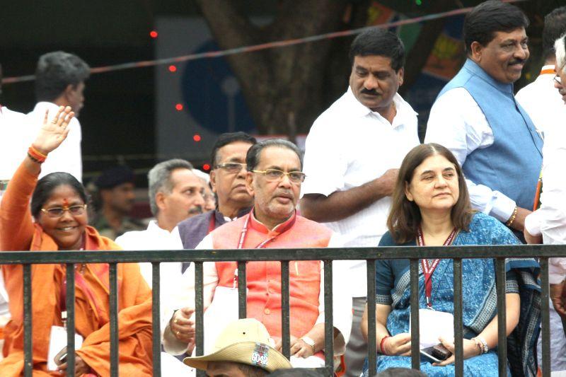 BJP MP Sadhvi Niranjan Jyoti with Union Cabinet Minister for Women and Child Development Maneka Gandhi during a public meeting in Bengaluru, on April 3, 2015. - Development Maneka Gandhi