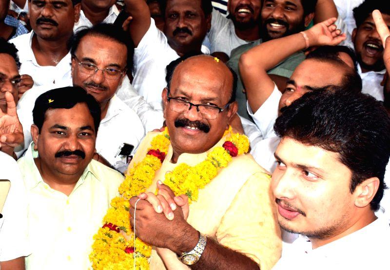 Bengaluru: BJP's Lok Sabha candidate from Kalaburagi Umesh Jadhav, who emerged victorious from the Lok Sabha parliamentary constituency against Congress' Mallikarjuna Kharge, celebrates with party workers in Karnataka's Kalaburagi, on May 23, 2019. (