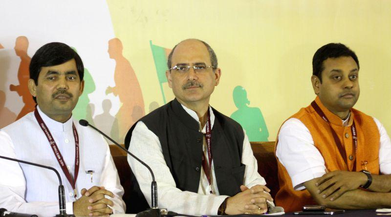 BJP spokespersons Syed Shahnawaz Hussain and Nalin Kohli address a conference BJP National Executive meeting in Bengaluru, on April 2, 2015. - Nalin Kohli